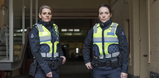 Two female police officers standing